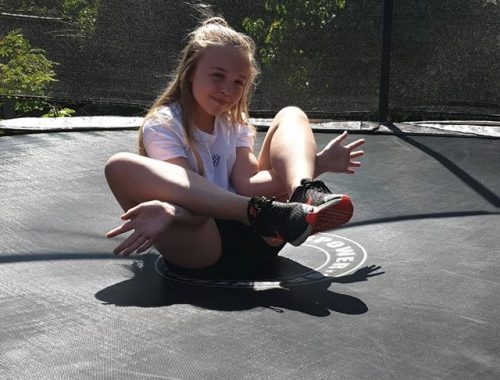 teenager on trampoline for birthday