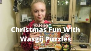 Girl holding wasgij Christmas puzzle