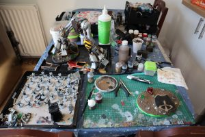 warhammer hobbying on table set up to paint during lockdown