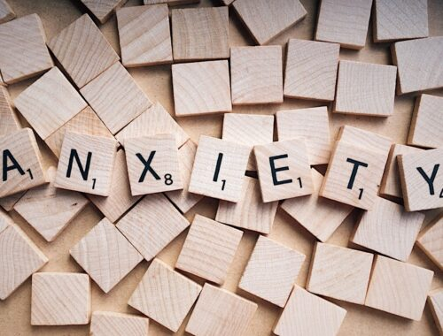 word tiles spelling out anxiety