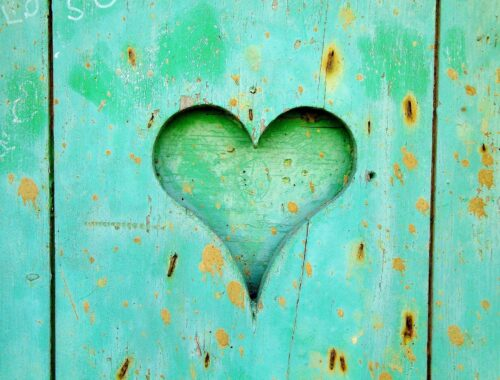 Planks of wood painted green with a heart cut out of the center piece