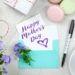 Stationery, flowers, cookies, a gift and a card for Mother's day on a table