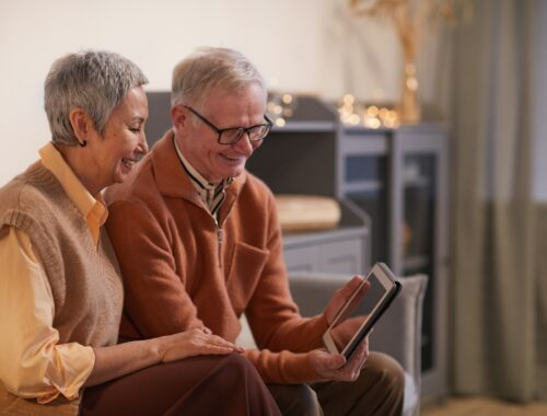 Older couple looking at a photo about their best lifephoto
